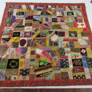 This quilt is like a waltz in fabric and stitches.....
