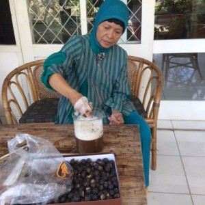 Ibu Karish makes the lather