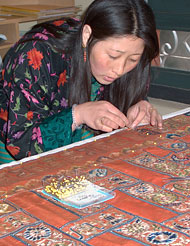 National Textile Museum staff member Choegho Kunzan working on a fabric in the museum's laboratory in Thimphu, Bhutan. Photo: Julia Brennan.